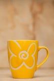 Yellow tea cup Royalty Free Stock Photos