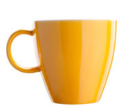 Yellow tea cup isolated on white royalty free stock photography
