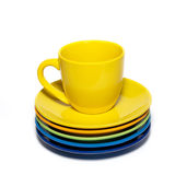 Yellow teacup and stack of saucer Stock Images