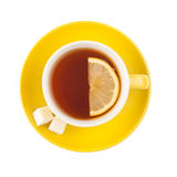 Yellow teacup with sugar and lemon. Isolated on white background Stock Photo