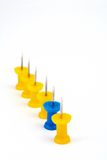Yellow team with focus on the leader blue Stock Photo
