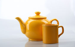 Yellow teapot and mug Royalty Free Stock Photos