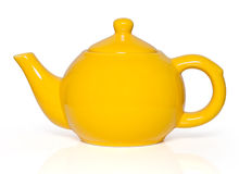 Yellow teapot on white background Stock Images