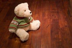 Yellow teddy bear. A yellow teddy bear on the floor Royalty Free Stock Image