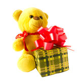 Yellow teddy bear with gift Stock Images