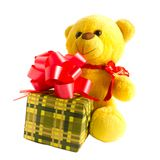 Yellow teddy bear with gift Royalty Free Stock Photo