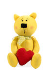 Yellow teddy bear with heart Royalty Free Stock Photography