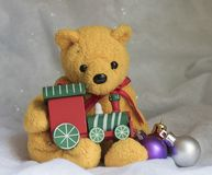 Teddy bear with Christmas train Stock Images