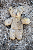 Yellow Teddy Bear Lies Wounded In A Pile Of Ash Royalty Free Stock Photos