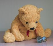 Teddy bear with marbles Royalty Free Stock Photography