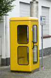 Yellow telephone booth Royalty Free Stock Image