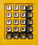 Yellow telephone keypad Royalty Free Stock Photo