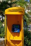 Yellow telephone kiosk, Rethymno. Stock Image
