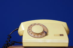 Yellow telephone set Stock Photos