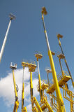 Yellow telescopic cranes under a blue sky Stock Image