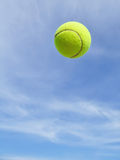 Yellow Tennis Ball in the Air Stock Images