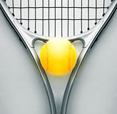 Tennis racket and ball. Yellow tennis ball on black and white backround stock photo