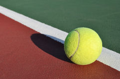 Yellow Tennis Ball on Court Stock Photos