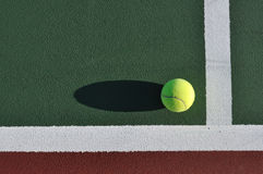 Yellow Tennis Ball on Court Stock Images