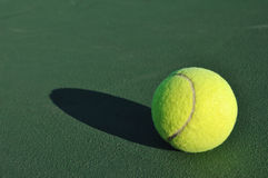 Yellow Tennis Ball on Court Stock Photography