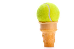 A yellow tennis ball in an ice cream cone. Vertical image of a yellow tennis ball in an ice cream cone on white Royalty Free Stock Images