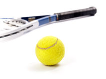 Yellow tennis ball and racket  on a white background Stock Images
