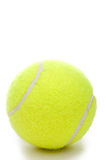 A yellow tennis ball on a white background. A vertical closeup of a yellow tennis ball on a white background Royalty Free Stock Photo