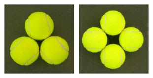 Yellow Tennis Balls - 1. New yellow tennis balls on a green court Royalty Free Stock Photos