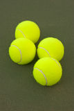 Yellow Tennis Balls - 10. New yellow tennis balls on a green court Stock Photo