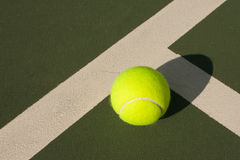Yellow Tennis Balls - 2. New yellow tennis balls on a green court Royalty Free Stock Photography