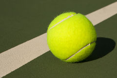 Yellow Tennis Balls - 3. New yellow tennis balls on a green court Stock Image