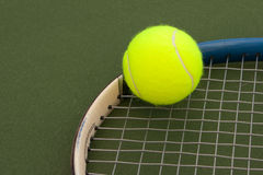 Yellow Tennis Balls - 4. New yellow tennis balls on a green court Royalty Free Stock Photography