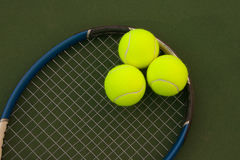 Yellow Tennis Balls - 5. New yellow tennis balls on a green court Stock Photography