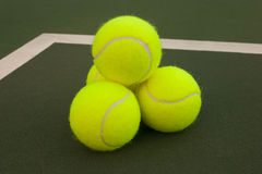 Yellow Tennis Balls - 6. New yellow tennis balls on a green court Royalty Free Stock Photo