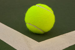 Yellow Tennis Balls - 7. New yellow tennis balls on a green court Stock Image