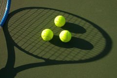 Yellow Tennis Balls - 8. New yellow tennis balls on a green court Stock Photo
