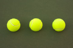Yellow Tennis Balls - 9. New yellow tennis balls on a green court Stock Images