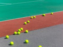 Yellow tennis balls on the tennis field. Big tennis royalty free stock photo
