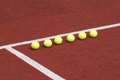Yellow tennis balls inline outdoor Royalty Free Stock Image