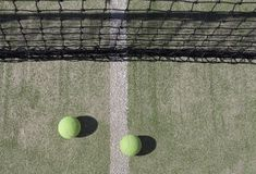 Tennis Balls with Net in the Background. Yellow Tennis Balls with Net in the Background Stock Photos