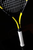 Yellow tennis racket Stock Images