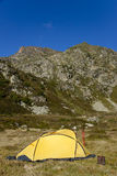 Yellow tent. Small yellow tent in Pyrenees mountain - Andora Stock Images