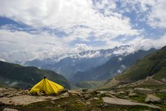 Yellow Tent. A yellow coloured tent is in front of the snowy mountain picks at Rothang Pass. Tourists want to experience the adventure of high altitude and hire Stock Photography
