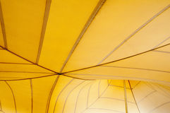 Yellow tent. Fragment of the upper part of the big yellow tent Stock Image
