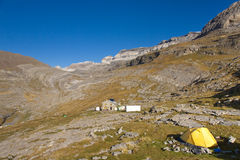 Yellow tent and in background refuge Goriz Stock Photography