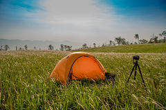 Yellow tent and camera Royalty Free Stock Photos