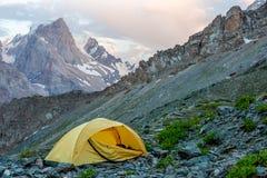 Yellow tent on mountain landscape Royalty Free Stock Photos
