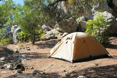 Yellow tent in a mountain wood. Yellow tent on tourist parking in  mountain wood Stock Photography