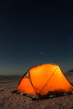 Yellow tent at night on the shore of lake Baikal in winter.  Royalty Free Stock Photography