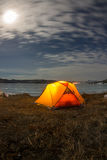 Yellow tent at night on the shore of lake Baikal in winter Royalty Free Stock Photo